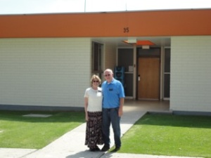 Elder and Sister Anthony in front of one of the apartments at the CCM like she stayed in 40 years ago.