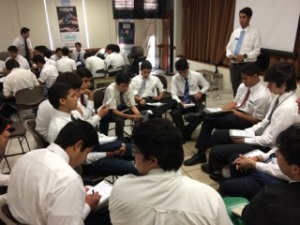 Groups of young men teaching one another the gospel
